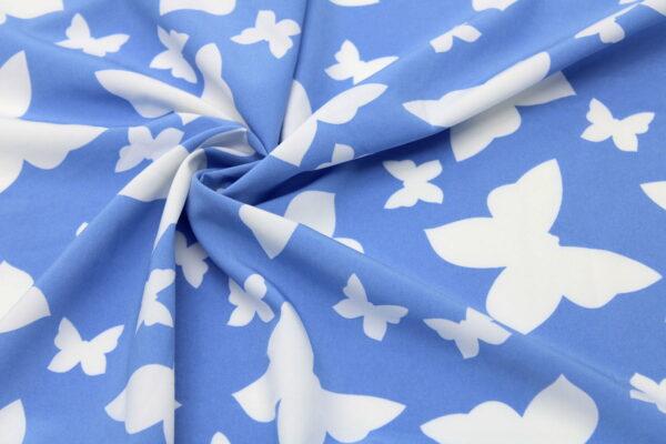 Tkanina Drukowana Bluzkowa Ecru Motylki Niebieskie Tło
