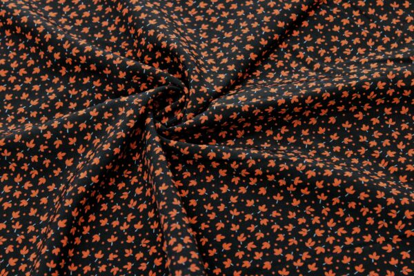 A Printed Fabric Red Leaves Black Background